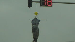 An effigy of a soldier hangs from a trffic light in Benghazi
