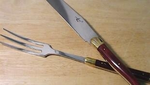 A carving knife and fork in the distinctive Laguiole design