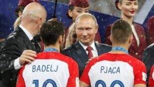 Soccer Football - World Cup - Final - France v Croatia - Luzhniki Stadium, Moscow, Russia - July 15, 2018 Croatia's Milan Badelj and Marko Pjaca receives their runners up medals from FIFA president Gianni Infantino and President of Russia Vladimir Putin du