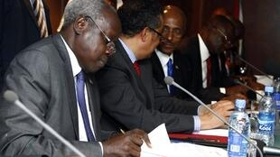 South Sudan's leader of the government's delegation Nhial Deng Nhial signs a ceasefire to end more than five weeks of fighting, Addis Ababa, 23 January, 2014