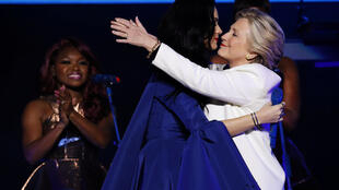 US Democratic presidential nominee Hillary Clinton reacts on stage with singer Katy Perry during a campaign concert and rally in Philadelphia, Pennsylvania, U.S., November 5, 2016.