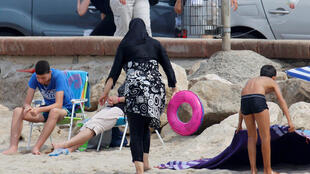 A woman wearing a burkini on a beach in Marseille