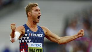 Kevin Mayer celebrates after winning decathlon gold at the world athletics championship.