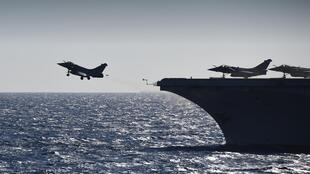 Planes take off from the Charles de Gaulle aircraft carrier
