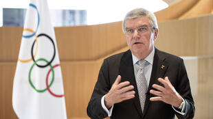 IOC chief Thomas Bach announcing unprecedented decision to postpone Tokyo Games on Tuesday