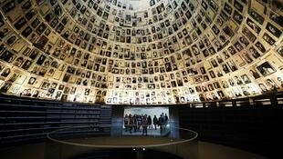 Visitors enter the Hall of Names to look at pictures of Jews killed in the Holocaust during a visit to the Holocaust History Museum