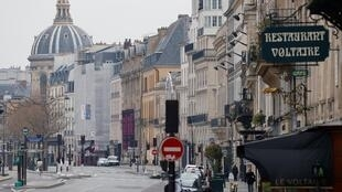 The Quai Voltaire in Paris now deserted after lockdown introduced.