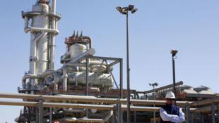 A technician stands at the Algerian Krechba gas treatment plant