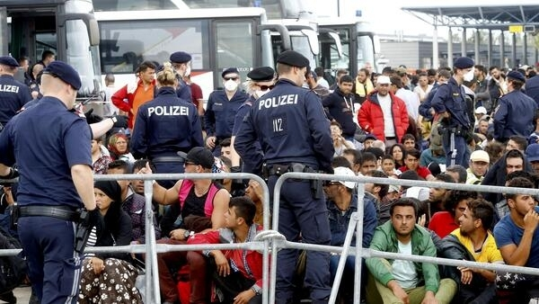 Migrants in the Austrian-Hungarian border, 14 September 2015. An estimated 200,000 asylum seekers have entered Austria since the start of September.