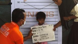 A Rohingya child being identified in Kuala Langsa, Indonesia on May 18, 2015.