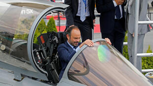 French Prime Minister Edouard Philippe sits in the cockpit of Dassault Rafale fighter as he visits the 52nd Paris Air Show at Le Bourget Airport near Paris, France June 23, 2017.