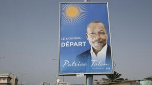A billboard campaigning for president elect Patrice Talon is seen along a road in the Akpakpa district in Cotonou