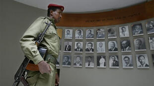 """An Ethiopian soldier contemplating a memorial dedicated to the victims of the """"Red Terror"""" under Megistu's regime."""