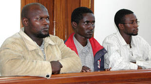 Idris Magondu (L), Hussein Hassan (C) and Mohammed Adan Abdow (R), appearing in Nakawa magistrates court in Kampala 30 July