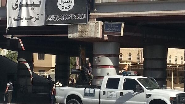 A fighter from the Islamic State mans an anti-aircraft gun in Mosul. 16 July 2014.