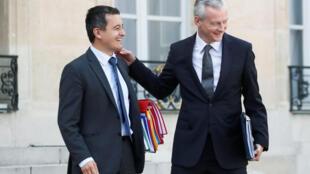 Президентское обещания конкретизировали министр бюджета Жеральд Дарманен (слева) и министр экономики Брюно Ле Мэр