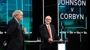 UK Prime Minister Boris Johnson and Labour leader Jeremy Corbyn during televised debate on 19 November, ahead of a general election