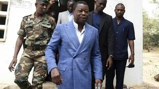 Gnassingbé leaves a polling station after casting his vote in Kara on 22 February 2020.