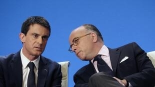 French Prime Minister Manuel Valls (L) and Interior minister Bernard Cazeneuve present the anti-racism plan in Créteil on Friday