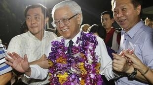 Tony Tan smiles as he arrives to thank his supporters after winning the presidential election in Singapore