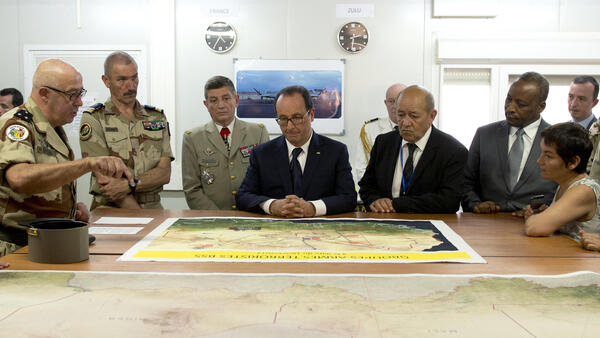 President François Hollande and Minister of Defense Jean-Luc Le Drian during their visit to Niamey, Niger. 18 July 2014.