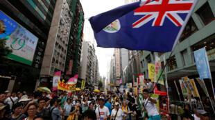 Dân Hồng Kông biểu tình ủng hộ dân chủ nhân kỷ niệm 19 năm ngày lãnh thổ này được Anh quốc trao trả cho Trung Quốc.