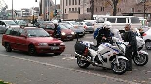 Motorcycle police carrying out identity check