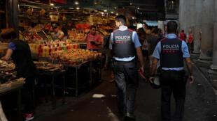 Catalan Mossos d'Escuadra patrol along La Boqueria market in Barcelona, Spain August 21, 2017.
