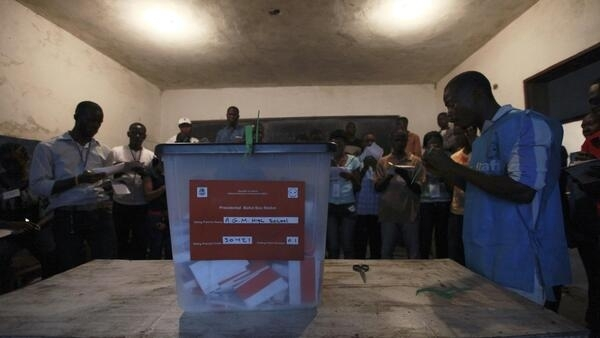 Polling agents start to count the ballots for the Liberian presidential election at a polling station in Monrovia
