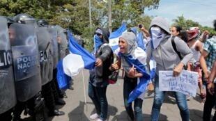 A demonstrator shouts slogans during a protest against Nicaraguan President Daniel Ortega's government in Managua, Nicaragua on 23 September 2018.