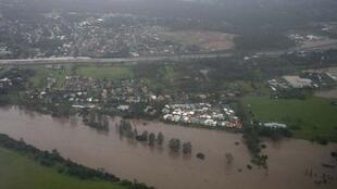 An aerial view of the rising Brisbane River is seen in the southern suburbs of Brisbane