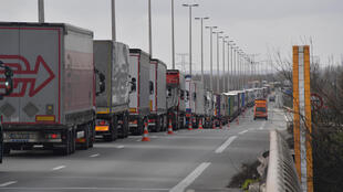 A picture taken at 10km from Dunkerque on the A16 highway between Dunkerque and Calais shows trucks stuck in a traffic jam on March 4, 2019 due to extensive controls by the customs officers protesting over the lack of staff and material ahead of Brexit