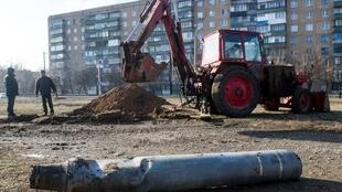 A municipal excavator digs out unexploded rockets in the eastern Ukrainian city of Kramatorsk