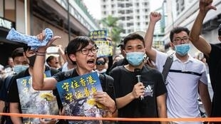 Protesters attend a rally against a controversial extradition law proposal in Sha Tin district of Hong Kong on 14 July 2019.
