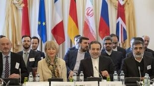 Abbas Araghchi (C-R), political deputy at the Ministry of Foreign Affairs of Iran, and the Secretary General of the European Union's External Action Service (EEAS) Helga Schmid (C-L) take part in a meeting of the Joint Commission of the Joint Comprehensive