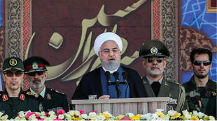 "Iranian Presidency, HO, AFP | A handout picture provided by the Iranian presidency on September 22, 2019 shows President Hassan Rouhani (C) giving a speech during the annual ""Sacred Defence Week""."