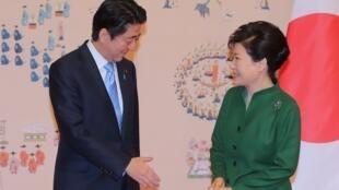 Japanese Prime Minister Shinzo Abe with South Korean President Park Geun-hye in November