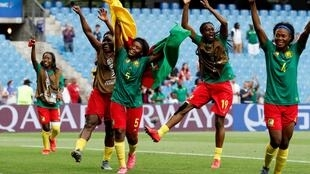 Cameroon's Indomitable Lionesses celebrate their qualification for the last 16 of the World Cup, Montpellier, France, 20 June 2019.