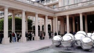 People wait for half an hour to visit the French Ministry of Culture in the Palais Royal in Paris on European Heritage Open Days 2016.