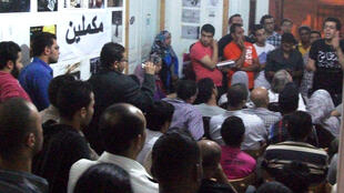 Volunteers from the Qestas organisation meet to discuss monitoring the presidential elections, 21 April 2012, Cairo