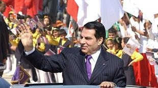 In this file photo taken on March 20, 2006 former Tunisian president Zine El Abidine Ben Ali waves to the crowd upon arrival in Rades stadium where he delivered his speech on the 50th anniversary of independence of Tunisia from France.