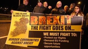 Anti-Brexit demonstrators at a protest rally on the night before Brexit on the border crossing between Jonesborough in Northern Ireland and Carrickarnon in the Irish Republic. January 31, 2020.