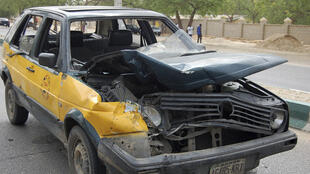 A car damaged by a bomb blast in Maiduguri, Nigeria, 8 June, 2012