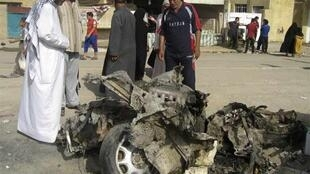 The wreckage of a car bomb in Abu Dsheer, southern Baghdad, Wednesday