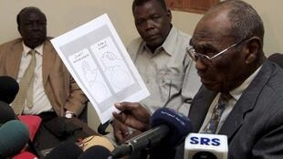 Southern Sudan Referendum Commission Chairperson Mohamed Ibrahim Khalil shows a sample voting card during a news conference in Khartoum