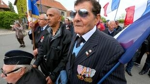 Harki veterans, former northern African soldiers of the French army during the Algerian national Liberation war (1957-62), and relatives take part in a march on May 10, 2014 in Colombey-les-deux-Eglises, where General Charles De Gaulle was buried. The Nati