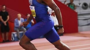 Christian Coleman claimed the men's 100 metres world championship title in 9.76 seconds.