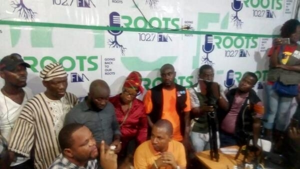 Council of Patriots chairman, Henry Costa (seated, far left) addresses press conference after postponement of anti-Weah protest, Monrovia, 30th December 2019