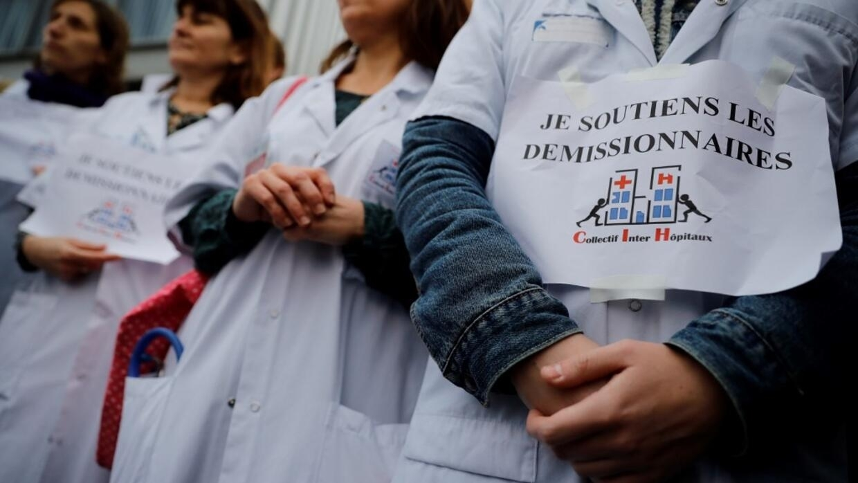 'Broken-hearted' French hospital staff strike with St. Valentine flowers and balloons