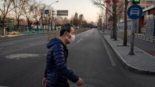 A man walks down the deserted streets of Wuhan, 31 January, 2020.